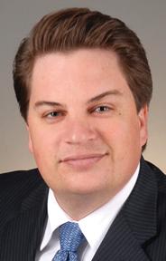 Adrian R White