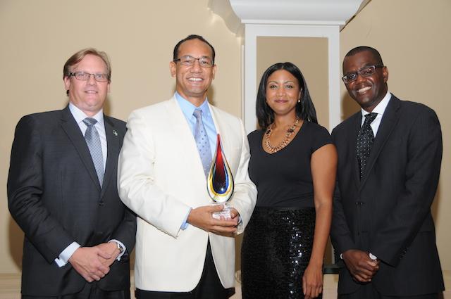 Photo: Hon. Ryan Pinder – Minister of Financial Services; John Delaney – EoY Award Recipient; Aliya Allen – BFSB Exec Director; Prince Rahming – BFSB Chairman
